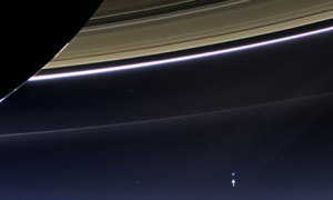 NASA's Cassini spacecraft  captures Saturn's rings and Earth and its moon in the same frame.